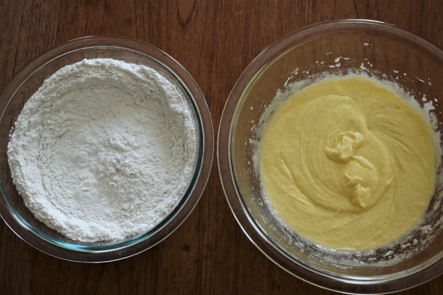 Two seperate bowls with wet ingredients in one and dry in another