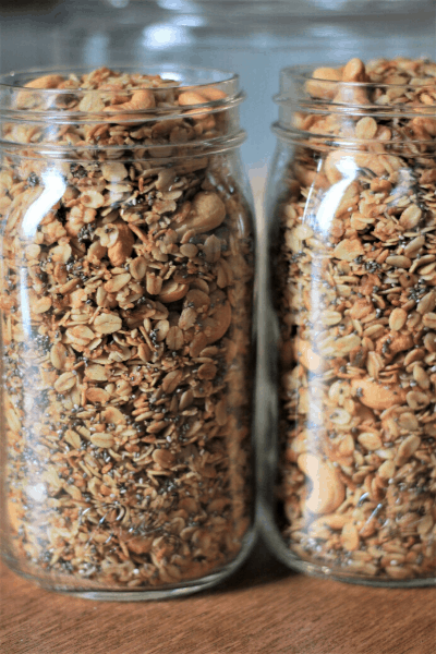 two 32 oz mason jars filled with easy granola recipe from scratch