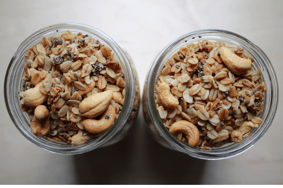 two glass mason jars filled with homemade granola pictures from above
